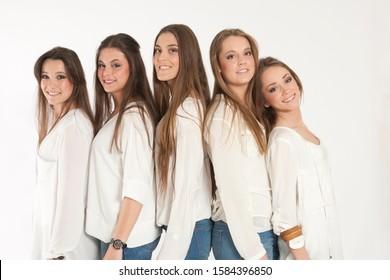 Group of happy girls posing