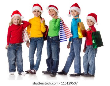 Group of happy kids with christmas gifts, isolated on white