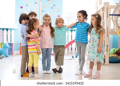 Group of happy kids at daycare or kindergarten