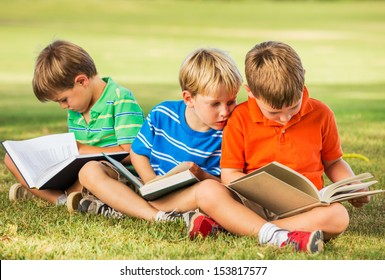 Group of Happy Kids Reading Books Outside, Friendship and Learning Concept