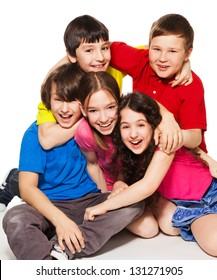 Group of happy kids sitting together and having fun