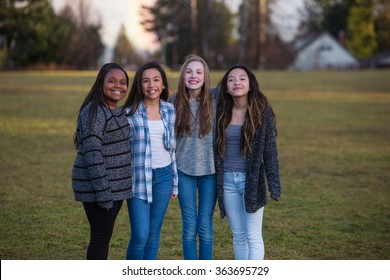 Group of happy kids standing together outside