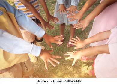 group of happy kids with  their hands at school. learning, activity, education, school, teamwork and cooperative concept /  Diversity, race, ethnicity, international and people.