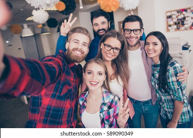 Group of happy laughing best friends making selfie.