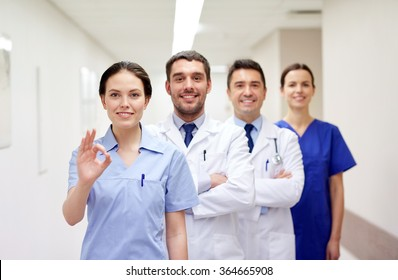 group of happy medics or doctors at hospital