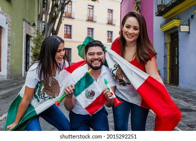 Group of happy mexican people holding flags at mexican party