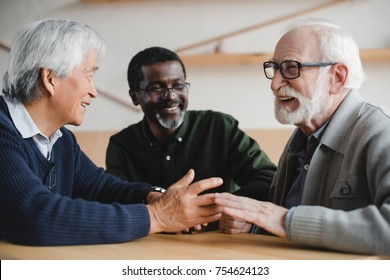 group of happy multiethnic senior friends spending time together