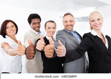 Group Of Happy Multiracial Businesspeople Gesturing Thumb Up Sign