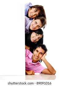 Group of happy people with a banner smiling - isolated over a white background