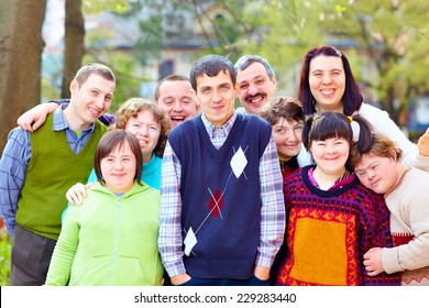 group of happy people with disabilities
