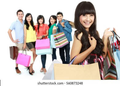 group of happy people shopping with paper bag