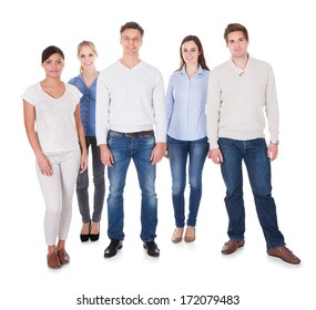 Group Of Happy People Standing Over White Background