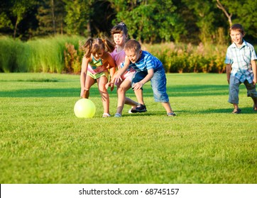 Group of happy preschool kids catching the ball