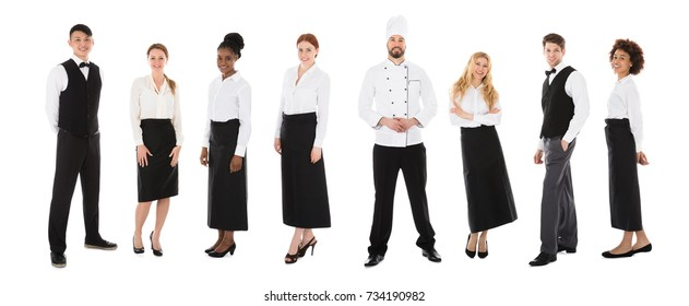 Group Of Happy Restaurant Staffs In A Line Over White Background