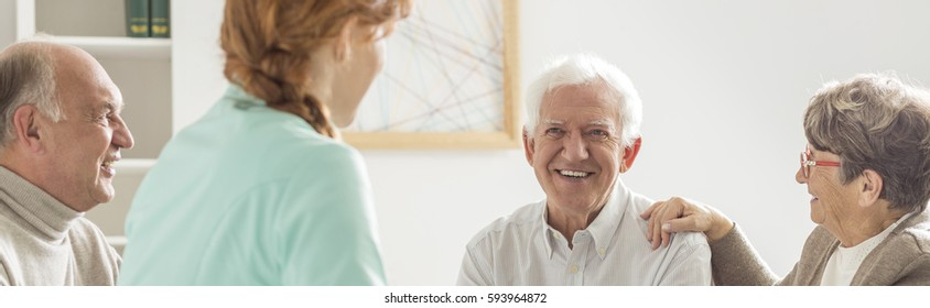 Group of happy seniors in retirement home spending time together