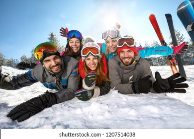 Group of happy skiers together on winter vacation