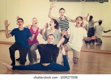 Group of happy teen with teacher in dance studio smiling and posing