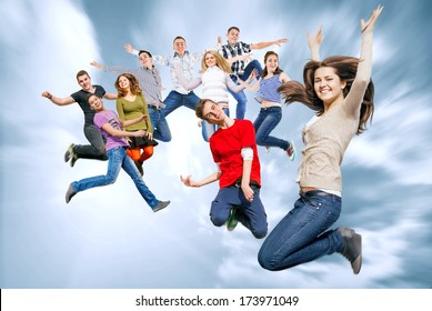 Group of happy teenage friends jumping in the sky