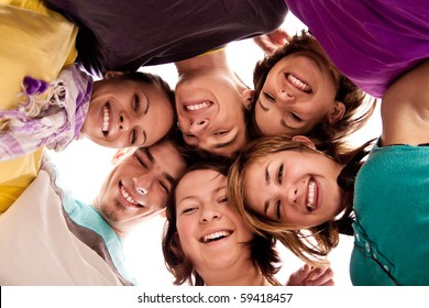 group of happy teenagers in circle �¢���� view from below