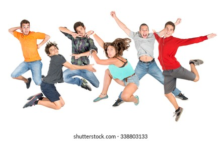 Group of happy teenagers jumping isolated in white