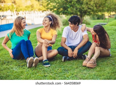 Group of happy teenagers in the park having fun spending time