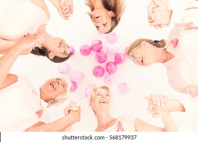 Group of happy women stick together in breast cancer fight