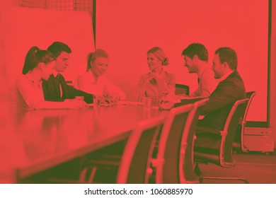 Group of happy young  business people in a meeting at officeduo tone