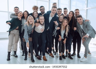 group of happy young business people pointing at you