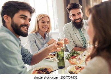 Group of happy young friends eating and having fun at home.Leisure,food,fun and people concept.