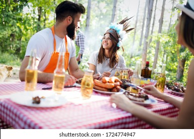 Group of happy young friends having barbecue party, outdoors