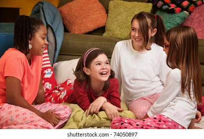 Group of happy young girls at a sleepover