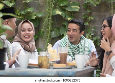 group of happy young muslim having dinner outdoor during ramadan celebration