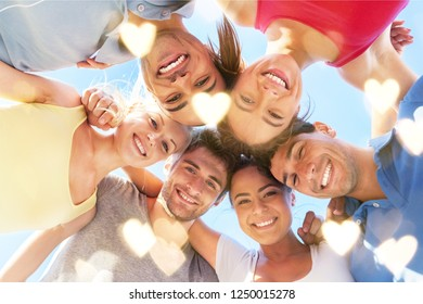 Group of happy young people in circle outdoors