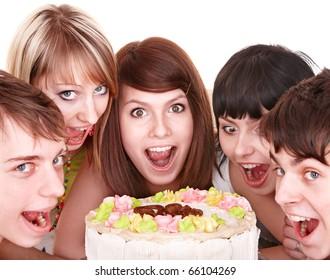 Group of happy young people eating cake. Isolated.