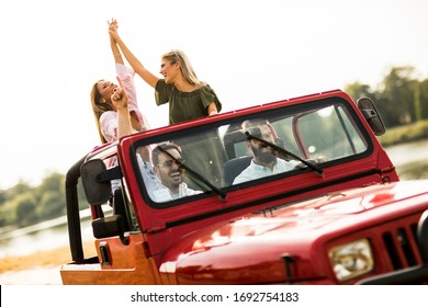Group of happy young people enjoying road trip