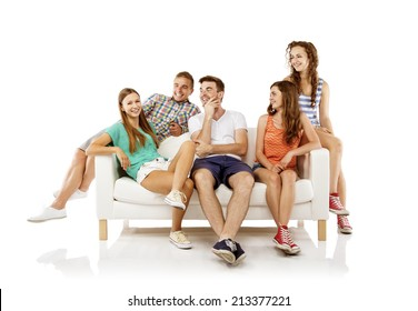 Group of happy young people sitting on sofa, isolated on white background. Best friends