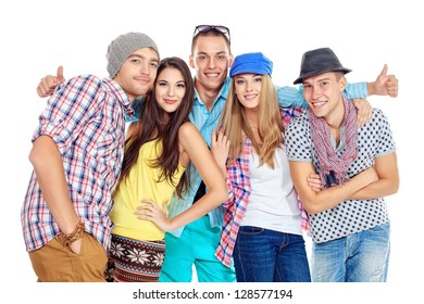 Group of happy young people standing together and showing thumbs. Friendship. Isolated over white.