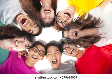 Group of happy  young student  with arms around each others shoulders
