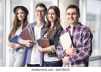 Group of happy young students in a university.