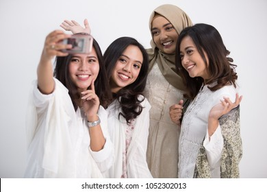 Group of happy young take a selfie together