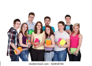 Group of happy young teenager students standing and smiling with books , isolated on white background.