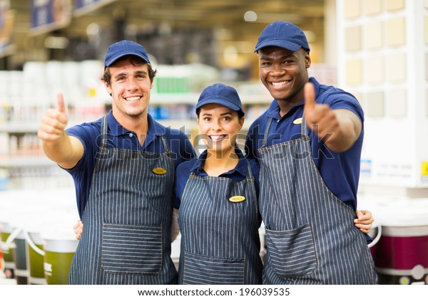 group hardware store workers giving thumbs up