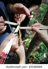 Group of harmonize people hand burning incense .
