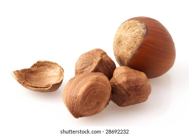 Group of hazelnuts, kernels and nutshells close-up on white background.