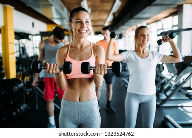 Group of healthy fitness people in gym