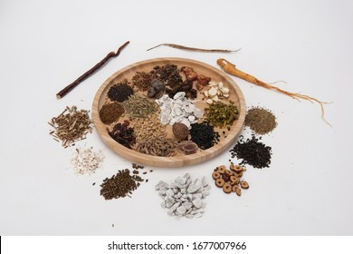 A group of herbs on a white background, large Chinese herbs in a wooden bowl, close-up of medicinal plants and aromatic plants