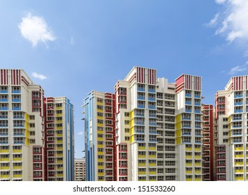 A group of high rise colorful residential apartments.