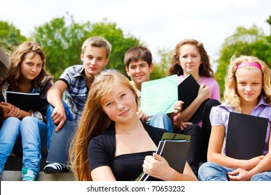 Group of high school students with books in hands
