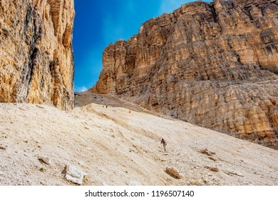 Group of hiker climbing up the Pordoi saddle at the Dolomite alps