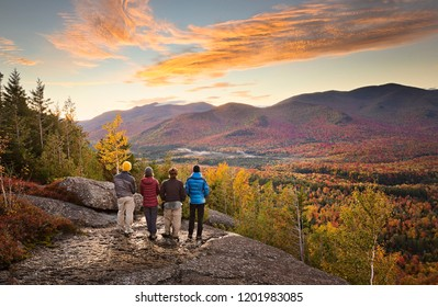 group of hikers enjoying the view in the Adirondacks